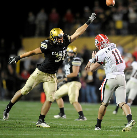 "University of Colorado linebacker Keenan Canty attempts to block a pass from Georgia quarterback Aaron Murray in the fourth quarter during the football game against University of Georgia on Saturday, Oct. 2, at Folsom Field. The Buffs defeated Georgia 29-27. <br /> For more photos go to  <a href=""http://www.dailycamera.com"">http://www.dailycamera.com</a><br /> Photo by Jeremy Papasso"