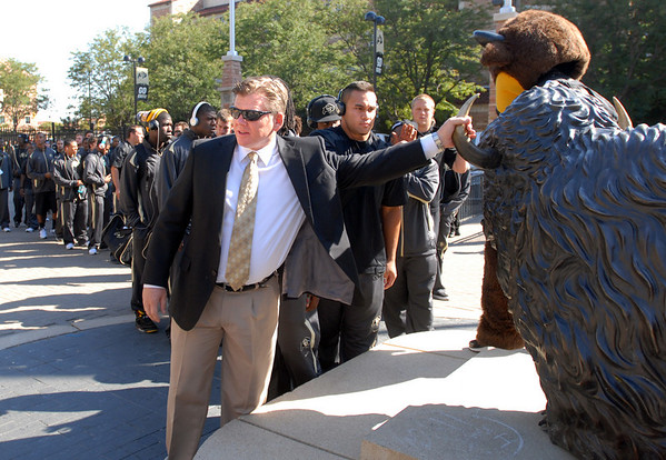 "Coach Dan Hawkins touches the buffalo statue outside Folsom Field.<br /> For more photos from the game go to  <a href=""http://www.dailycamera.com"">http://www.dailycamera.com</a>.<br /> Cliff Grassmick / October 2, 2010"