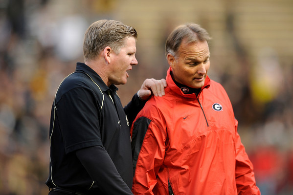 "University of Colorado Head Coach Dan Hawkins talks with Georgia Head Coach Mark Richt prior to the start of the football game against University of Georgia on Saturday, Oct. 2, at Folsom Field. For more photos go to  <a href=""http://www.dailycamera.com"">http://www.dailycamera.com</a><br /> Photo by Jeremy Papasso"
