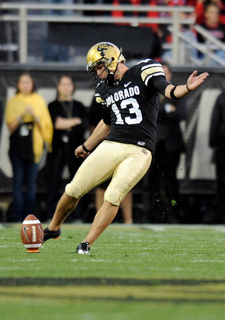 "University of Colorado place kicker Aric Goodman kicks off the ball in the first quarter of the football game against University of Georgia on Saturday, Oct. 2, at Folsom Field.<br />  For more photos go to  <a href=""http://www.dailycamera.com"">http://www.dailycamera.com</a><br /> Photo by Jeremy Papasso"