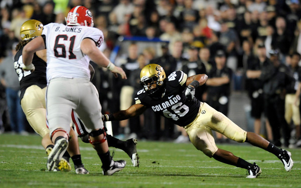 "University of Colorado safety Anthony Perkins attempts a tackle during the football game against University of Georgia on Saturday, Oct. 2, at Folsom Field. The Buffs defeated Georgia 29-27. <br /> For more photos go to  <a href=""http://www.dailycamera.com"">http://www.dailycamera.com</a><br /> Photo by Jeremy Papasso"