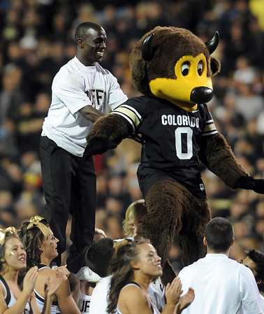 CU cheerleader, Ozell Williams, prepares to flip over Ralphie.<br /> Cliff Grassmick / October 2, 2010