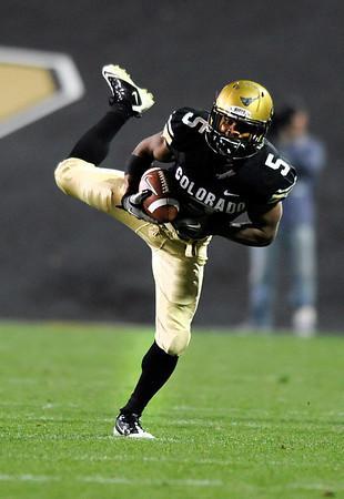 "University of Colorado tailback Rodney Stewart makes a leaping catch during the football game against University of Georgia on Saturday, Oct. 2, at Folsom Field. The Buffs defeated Georgia 29-27. <br />  For more photos go to  <a href=""http://www.dailycamera.com"">http://www.dailycamera.com</a><br /> Photo by Jeremy Papasso"