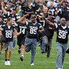 "The 1990 National Championship team ran behind Ralphie.<br /> For more photos from the game go to  <a href=""http://www.dailycamera.com"">http://www.dailycamera.com</a>.<br /> Cliff Grassmick / October 2, 2010"