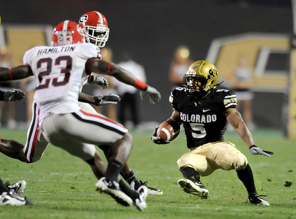 "University of Colorado tailback Rodney Stewart jukes Georgia defender Jakar Hamilton, No. 23, during the football game against University of Georgia on Saturday, Oct. 2, at Folsom Field. The Buffs defeated Georgia 29-27. <br /> For more photos go to  <a href=""http://www.dailycamera.com"">http://www.dailycamera.com</a><br /> Photo by Jeremy Papasso"