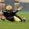 "University of Colorado tailback Rodney Stewart goes down after being tripped up by a Georgia defender while rushing the ball during the football game against University of Georgia on Saturday, Oct. 2, at Folsom Field. For more photos go to  <a href=""http://www.dailycamera.com"">http://www.dailycamera.com</a><br /> Photo by Jeremy Papasso"