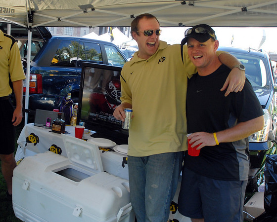 "David Youngquest, left, and Grey Kennedy, tailgating before the Georgia game in Boulder.<br /> For more photos from the game go to  <a href=""http://www.dailycamera.com"">http://www.dailycamera.com</a>.<br /> Cliff Grassmick / October 2, 2010"