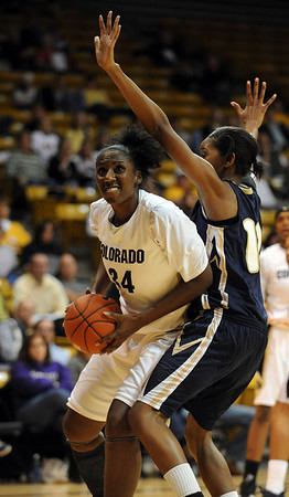 Courtney Dunn of CU goes up to score on Candice Ivy of Georgia Southern.<br /> <br /> Cliff Grassmick /November 27, 2009