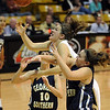Kelly Jo Mullaney of CU drives between Kayla Dayton, left, and Jamie Navarro of Georgia Southern on Friday.<br /> Cliff Grassmick /November 27, 2009