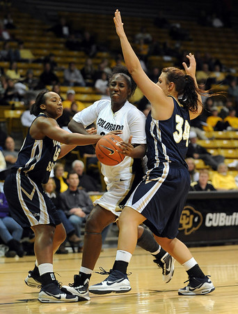 Courtney Dunn of CU drives between J'Lisia Ogburn, left, and Jessica Geiger of Georgia Southern.<br /> <br /> Cliff Grassmick /November 27, 2009