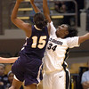 Courtney Dunn (34) of CU  goes up to defend a shot by J'Lisia Ogburn of Georgia Southern.<br /> <br /> Cliff Grassmick /November 27, 2009