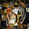 Brittany Spears of CU drives to the basket against Candice Ivy of Georgia Southern on Friday.<br /> <br /> Cliff Grassmick /November 27, 2009