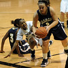 Jamie Navarro (5) of Georgia Southern gets to a ball in front of Whitney Houston of CU.<br /> <br /> Cliff Grassmick /November 27, 2009