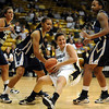 Kelly Jo Mullaney of CU gets a pass away before falling against Georgia Southern.<br /> <br /> Cliff Grassmick /November 27, 2009