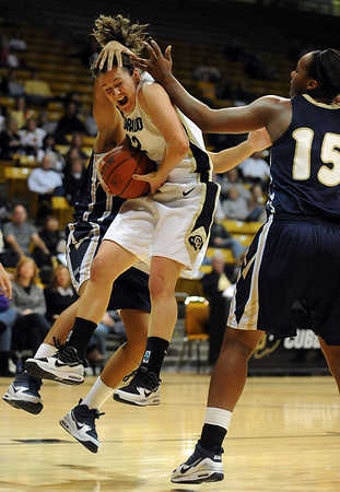 Kelly Jo Mullaney  of CU flies in to get a rebound against Georgia Southern Friday night.<br /> <br /> Cliff Grassmick /November 27, 2009