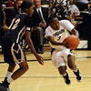 Whitney Houston of CU drives past Candice Ivy of Georgia Southern.<br /> <br /> Cliff Grassmick /November 27, 2009