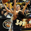 Meagan Malcolm-Peck of CU shoots over Jessica Geiger of the Eagles.<br /> <br /> Cliff Grassmick /November 27, 2009