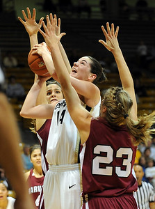 Meagan Malcolm-Peck goes up against Jackie Alemany of Harvard among others.  Cliff Grassmick /November 28, 2009
