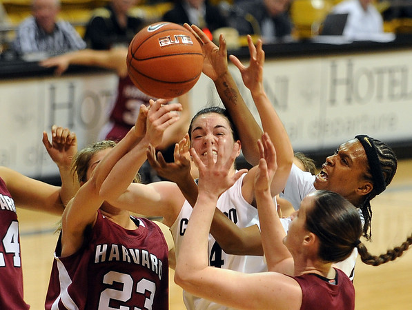 Meagan Malcolm-Peck, center and Brittany Spears of Colorado get mixed up inside with Harvard.<br /> Cliff Grassmick /November 28, 2009