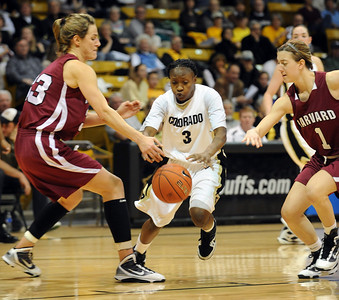 Whitney Houston tries to get control of the ball between Emma Markley, left, and Elle Hagedorn of Harvard.  Cliff Grassmick /November 28, 2009