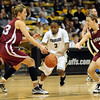 Whitney Houston tries to get control of the ball between Emma Markley, left, and Elle Hagedorn of Harvard.<br /> <br /> Cliff Grassmick /November 28, 2009
