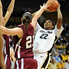 Brittany Spears of CU puts up a shot over Victoria Lippert of Harvard.<br /> <br /> Cliff Grassmick /November 28, 2009