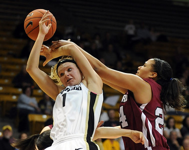 Alyssa Fressle of CU gets fouled by Claire Wheeler of Harvard.  Cliff Grassmick /November 28, 2009