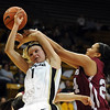 Alyssa Fressle of CU gets fouled by Claire Wheeler of Harvard.<br /> <br /> Cliff Grassmick /November 28, 2009