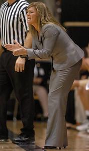 Kathy McConnell-Miller encourages the Buffs against Harvard.  Cliff Grassmick /November 28, 2009
