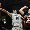 "Alec Burks of CU tries to score past Deividas Busma of Idaho State.<br /> For more photos of the game, go to  <a href=""http://www.dailycamera.com"">http://www.dailycamera.com</a><br /> Cliff Grassmick / November 12, 2010"