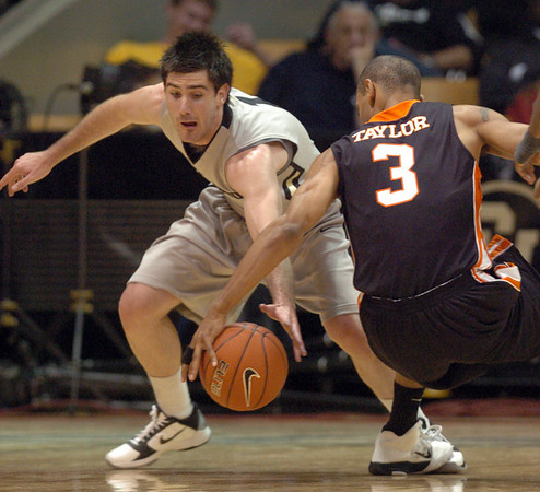 "Nate Tomlinson of CU tries to get the steal from Phyllip Taylor of Idaho State.<br /> For more photos of the game, go to  <a href=""http://www.dailycamera.com"">http://www.dailycamera.com</a><br /> Cliff Grassmick / November 12, 2010"