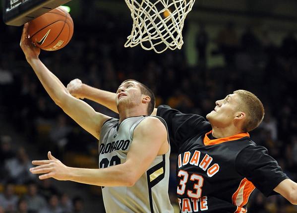 """Austin Dufault of CU scores around Deividas Busma of Idaho State.<br /> For more photos of the game, go to  <a href=""""http://www.dailycamera.com"""">http://www.dailycamera.com</a><br /> Cliff Grassmick / November 12, 2010"""