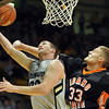 "Austin Dufault of CU scores around Deividas Busma of Idaho State.<br /> For more photos of the game, go to  <a href=""http://www.dailycamera.com"">http://www.dailycamera.com</a><br /> Cliff Grassmick / November 12, 2010"