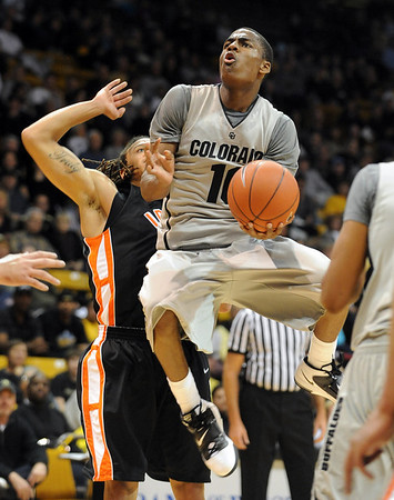 "Alec Burks of CU drives past Mike Lacy of Idaho State.<br /> For more photos of the game, go to  <a href=""http://www.dailycamera.com"">http://www.dailycamera.com</a><br /> Cliff Grassmick / November 12, 2010"