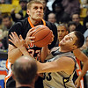 "Austin Dufault, right,  of CU struggles for a rebound with Deividas Busma of Idaho State.<br /> For more photos of the game, go to  <a href=""http://www.dailycamera.com"">http://www.dailycamera.com</a><br /> Cliff Grassmick / November 12, 2010"