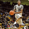 "Alec Burks  of CU goes up to slam one home against Idaho State.<br /> For more photos of the game, go to  <a href=""http://www.dailycamera.com"">http://www.dailycamera.com</a><br /> Cliff Grassmick / November 12, 2010"