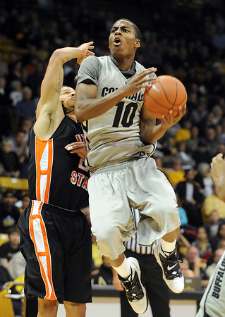 """Alec Burks of CU drives past Mike Lacy of Idaho State.<br /> For more photos of the game, go to  <a href=""""http://www.dailycamera.com"""">http://www.dailycamera.com</a><br /> Cliff Grassmick / November 12, 2010"""