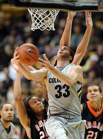 "Austin Dufault of CU flies under the basket against Idaho State on Friday.<br /> For more photos of the game, go to  <a href=""http://www.dailycamera.com"">http://www.dailycamera.com</a><br /> Cliff Grassmick / November 12, 2010"
