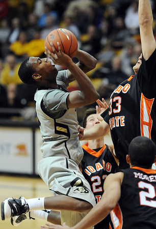 "Alec Burks of CU, drives to the basket against Idaho State on Friday.<br /> For more photos of the game, go to  <a href=""http://www.dailycamera.com"">http://www.dailycamera.com</a><br /> Cliff Grassmick / November 12, 2010"