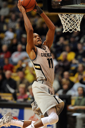"""Cory Higgins of CU goes in for the dunk against Idaho State on Friday.<br /> For more photos of the game, go to  <a href=""""http://www.dailycamera.com"""">http://www.dailycamera.com</a><br /> Cliff Grassmick / November 12, 2010"""