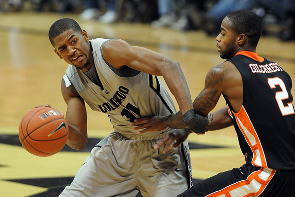 """Cory Higgins of CU, tries to get around Broderick Gilchrist of Idaho State.<br /> For more photos of the game, go to  <a href=""""http://www.dailycamera.com"""">http://www.dailycamera.com</a><br /> Cliff Grassmick / November 12, 2010"""
