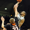 "Cory Higgins of  the University of Colorado, shoots over Deividas Busma of Idaho State, during the November 12, 2010 game in Boulder.<br /> For more photos of the game, go to  <a href=""http://www.dailycamera.com"">http://www.dailycamera.com</a><br /> Cliff Grassmick / November 12, 2010"