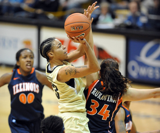 "Chucky Jeffery of Colorado drives to the basket over Lana Rukavina of  Illinois during the CU loss.<br /> For more photos of the game, go to  <a href=""http://www.dailycamera.com"">http://www.dailycamera.com</a>.<br /> Cliff Grassmick / December 4, 2010"