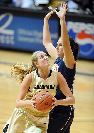 """Julie Seabrook of Colorado puts up a shot on Lana Rukavina of Illinois on Saturday.<br /> For more photos of the game, go to  <a href=""""http://www.dailycamera.com"""">http://www.dailycamera.com</a>.<br /> Cliff Grassmick / December 4, 2010"""