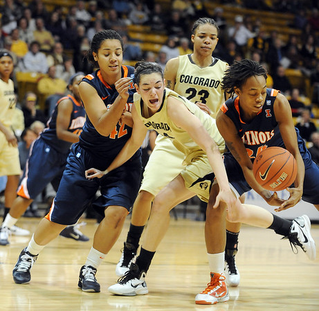 "Meagan Malcolm-Peck, center, of Colorado, tries to get a loose ball from Adrienne Godbold, right, of Illinois.<br /> For more photos of the game, go to  <a href=""http://www.dailycamera.com"">http://www.dailycamera.com</a>.<br /> Cliff Grassmick / December 4, 2010"