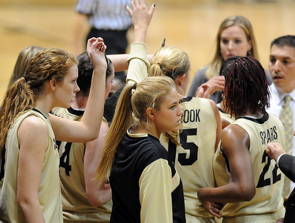 "Nikki Lindow, center, of the CU volleyball team, suited up for the basketball team Saturday.<br /> For more photos of the game, go to  <a href=""http://www.dailycamera.com"">http://www.dailycamera.com</a>.<br /> Cliff Grassmick / December 4, 2010"