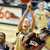 "Julie Seabrook of CU tries to get a rebound over Adrienne Godbold of Illinois on Saturday.<br /> For more photos of the game, go to  <a href=""http://www.dailycamera.com"">http://www.dailycamera.com</a>.<br /> Cliff Grassmick / December 4, 2010"