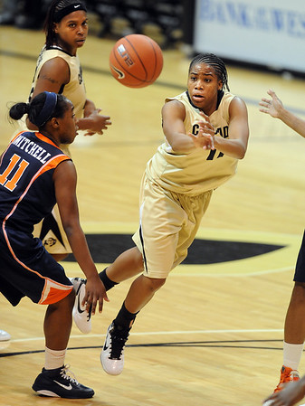 "Brittany Wilson of CU passes the ball past  Eboni Mitchell of Illinois.<br /> For more photos of the game, go to  <a href=""http://www.dailycamera.com"">http://www.dailycamera.com</a>.<br /> Cliff Grassmick / December 4, 2010"