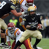 "Rodney Stewart of CU, looks for room to run against Iowa State.<br /> For more photos of the game, go to  <a href=""http://www.dailycamera.com"">http://www.dailycamera.com</a><br /> Cliff Grassmick / November 13, 2010"