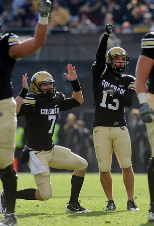 "Cody Hawkins, left, and Aric Goodman, celebrate a FG against Iowa State.<br /> For more photos of the game, go to  <a href=""http://www.dailycamera.com"">http://www.dailycamera.com</a><br /> Cliff Grassmick / November 13, 2010"
